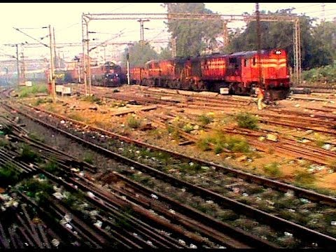 Departing from Mughal Sarai Junction, and crossing plethora of freights: WAP-4 LHB Poorva