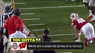 Highlights Urban Meyer get whacked in the face by referee who then gave Ohio State a 15-yard penalty