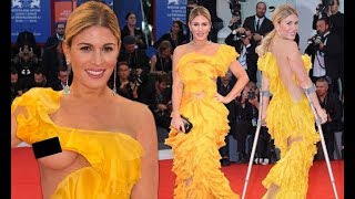 Hofit Golan suffers embarrassing nip slip as she hobbles up the red carpet