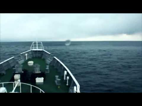 Japan, Tsunami. Coast Guard ship rides over the tsunami waves. 日本 - 津波