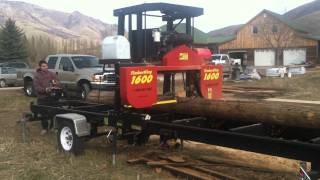 Portable Sawmill For Hire - Sawing Telephone Poles For Exterior Lumber