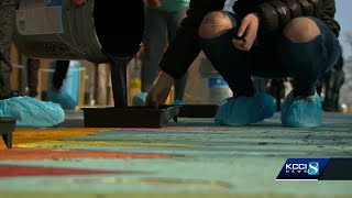 Students paint iconic street to make stand against hate