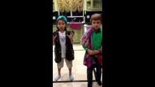 Two kids are lip synching 20 dollars in my pocket - Thrift Shop song
