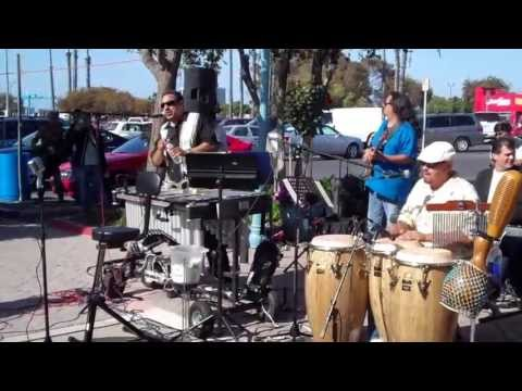 Bob's Latin Band with people dancing to One Calamera