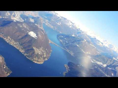 Winter Flight over the Swiss Alps and Visual Approach in Lugano LSZA