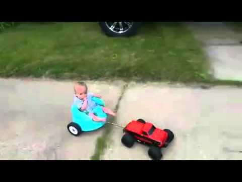 Baby in remote controlled trailer