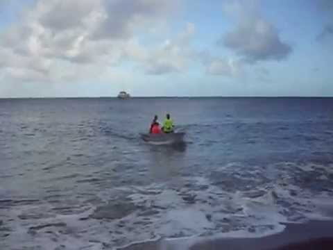 Landing a launch boat on the beach of Agrigan Island, Northern Marianas