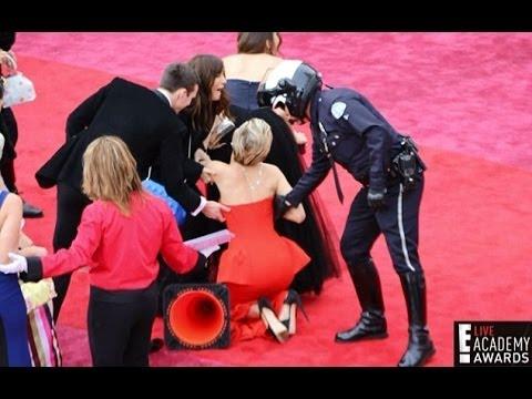 Jennifer Lawrence trips on Oscars red carpet