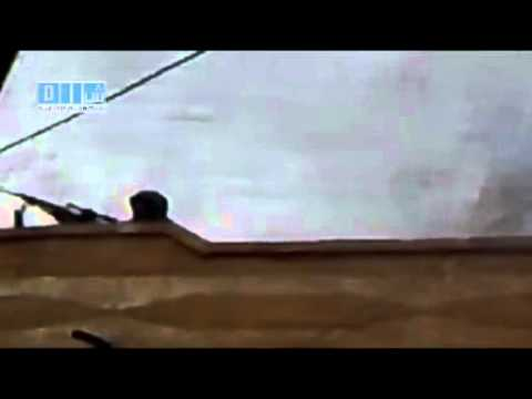Sniper on a roof in Deraa
