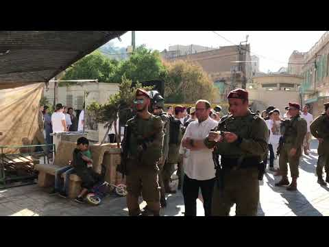 Israeli Occupation Forces And Armed Settlers In Hebron Market