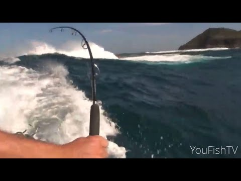BOAT SURFING BIG WAVES TO GET FISH HOOK UPS!