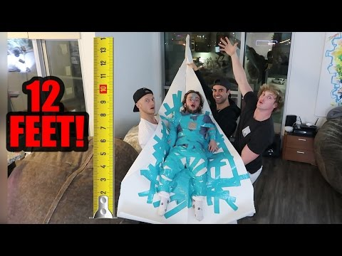 Thumbnail: DWARF ATTACHED TO 12-FOOT PAPER AIRPLANE! (will it fly!?)