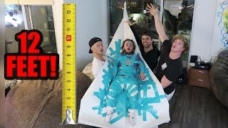 DWARF ATTACHED TO 12-FOOT PAPER AIRPLANE! (will it fly!?) thumbnail
