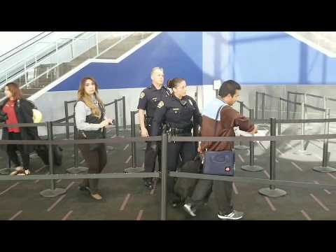 man tries to run pass tsa checkpoint lax airport police at work at Los Angeles International Airport