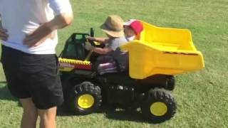 Brooks and Collins riding the new power wheels dump truck