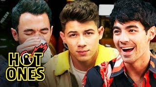 Download The Jonas Brothers Burn Up While Eating Spicy Wings | Hot Ones Mp3 and Videos