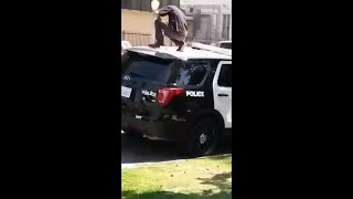 Man jumping on police car