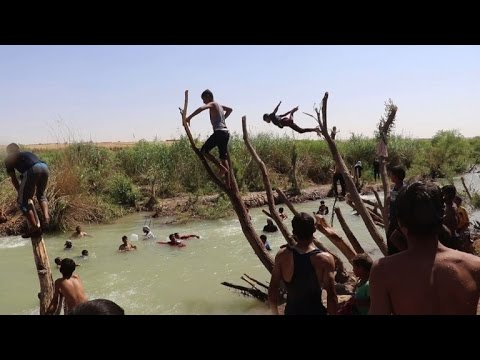 Down to the river for youths from Iraq's embattled Mosul
