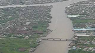 Garuda Indonesia fly above Kapuas river Pontianak