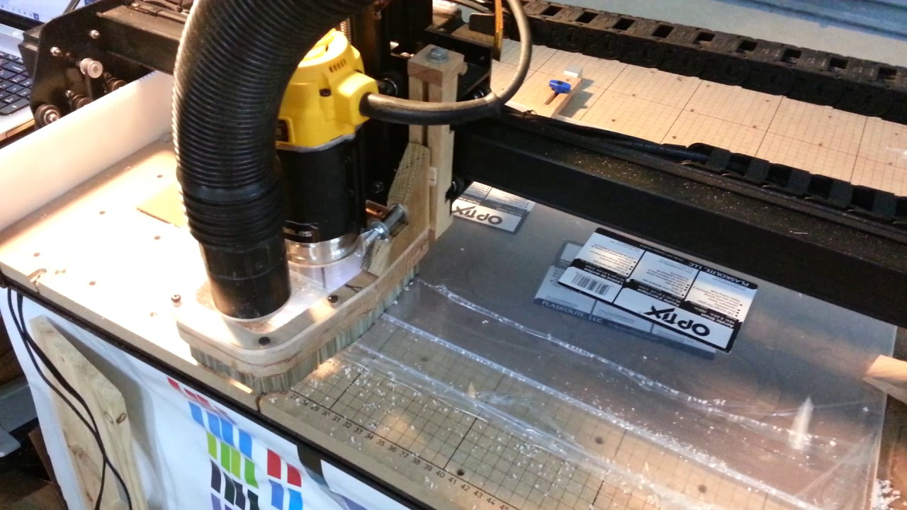 Download X-carve cutting a straight edge on 3 pieces of poly carbonate.