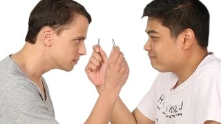 Men Pluck Each Other's Nose Hair