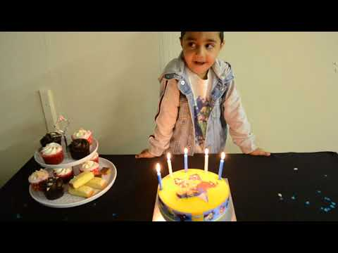 Hisham's 5th Birthday!!  Birthday cake, candles and singing.