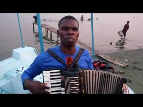 Divine Boakye Amponsah singing gospel medley on accordion