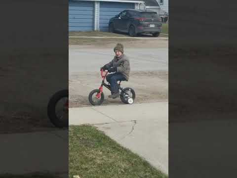 Confused Little Boy Can't Figure out Why Bike Won't Move - 1034438