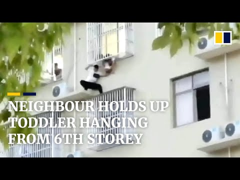 Neighbour holds up toddler hanging from 6th storey in China