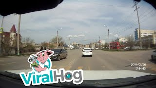 Man Tries to Avoid Oncoming Car, Fails || ViralHog
