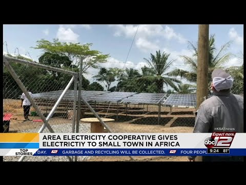 Area electricity cooperative gives electricity to small town in Africa
