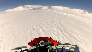 Arctic cat XF 1100 speeding over frozen landscape