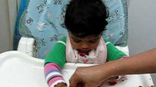 Gambar cover 10 months Bhavana eating plum