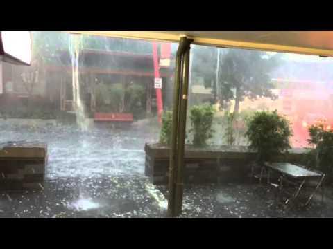 Insane hail storm. Lady gets pummelled, Brisbane Nov 27