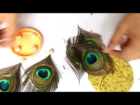 Eco friendly Ganpati decoration idea for home   Peacock feather Ganpati decoration backdrop from YouTube · Duration:  11 minutes 2 seconds