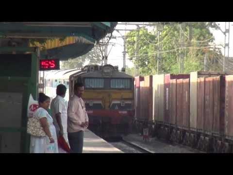 KANYAKUMARI EXPRESS OVERTAKING A FREIGHT TRAIN AT BHIVPURI ROAD !!!!!