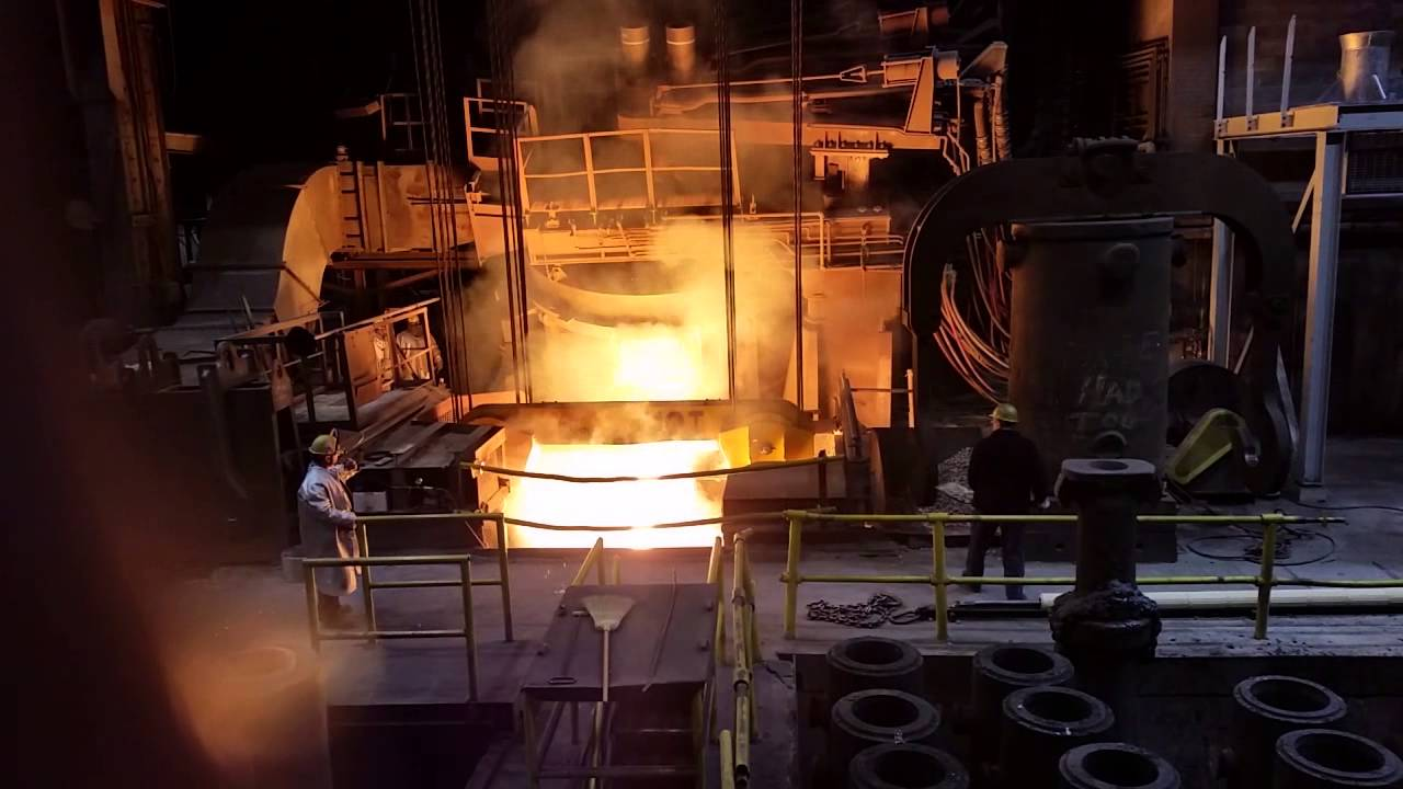 electric arc furnace tapping into ladle