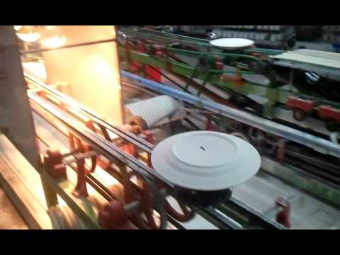 Automatic ceramic plate glazing machine