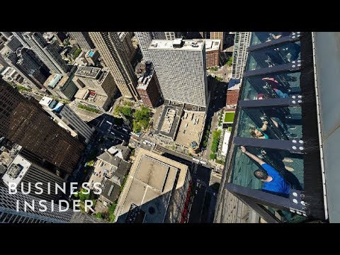 This ride lets you lean out over 1,000 feet above Chicago