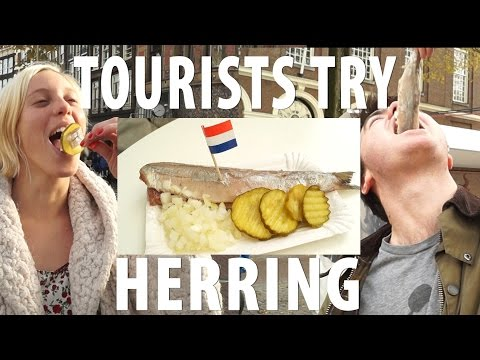 Tourists Try Dutch Herring