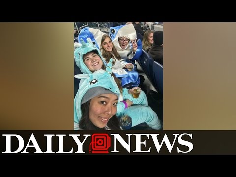 John Oliver Contest Winners At The Yankees Game Wear Unicorn & Shark Outfits