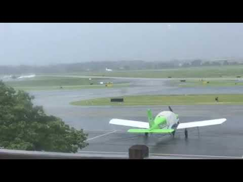 Private jet takeoff from Dekalb peachtree airport in rainy weather.