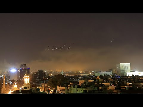 Amateur footage shows missiles falling over Damascus as air strikes begin