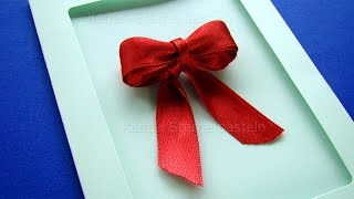 Weihnachtskarten basteln: DIY Schleifen binden mit Geschenkband. Geschenkschleife selber machen