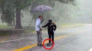 When Family Spots Cop In Pouring Rain, They Pull Over To See What S...