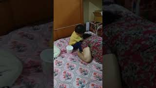 Malini putting hair oil to Mom