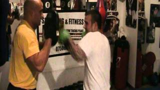 """Ste """"the mittologist"""" Barlow getting Boxer Dan """"The Ding-a-Ling Man"""" Elms on pad workout drill"""