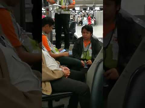 Airport staff in BKK Airport openly consume whiskey on the job