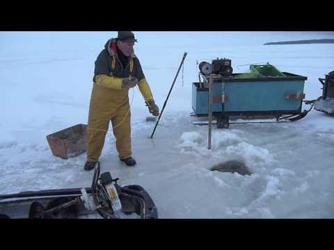 Ice fishing lake winnipeg part 2 youtube for Lake winnipeg fishing report