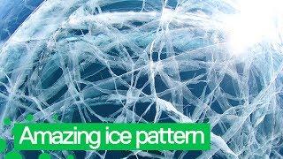 Man Shows Amazing Ice Pattern on Lake Baikal, Siberia